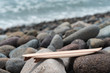 Miniature Surfboard Model at cobblestone Beach