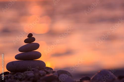 stack of zen stones on pebble beach Wallpaper Mural