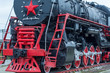 big steam locomotive with a red star, wheels of old steam locomotives. a pair of wheels. retro locomotives. vintage