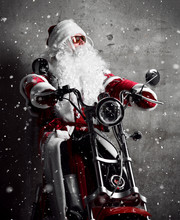 Santa Claus Sitting On  Electric Motorcycle Bicycle Scooter With Text Copy Space Under Snow. New Year And Merry Christmas