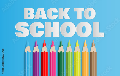 Fotografía  Back to school text with set of colored pencils on blue background
