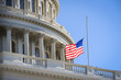 US Capitol Building with a flag on a half staff