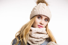 Winter Close-up Portrait Of Attractive Young Blonde Woman Wearing Beige Warm Knitted Hat With Fur Pompom And Scarf