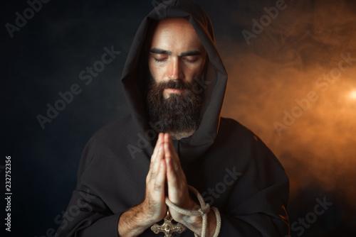 Medieval monk praying with closed eyes Fototapeta