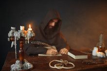 Medieval Monk Sitting At Table And Write, Top View