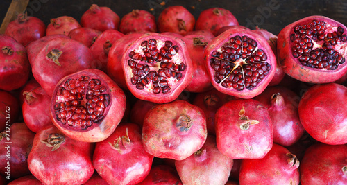 JClose-up of Punica, Pomegranate. Sale of fresh of ripe juicy pomegranates, farmer's bazaar, open showcases of market.