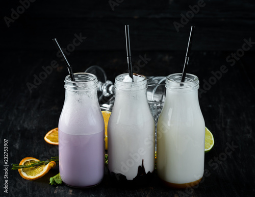 Milk-shake. Ice cream, milk and fruit. On a wooden background. Top view.