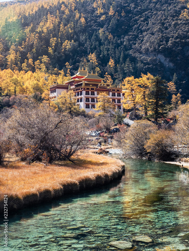 Photographie Chonggu Temple with pine forest and emerald river in autumn