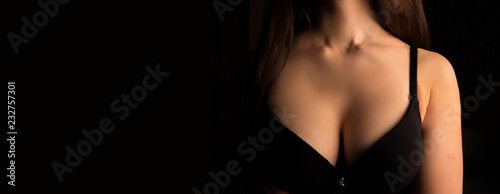 Obraz Beautiful woman's breasts in bra on black background - fototapety do salonu