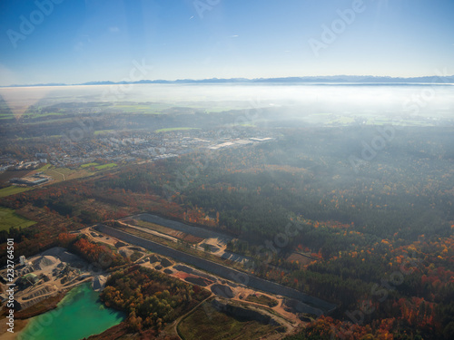 Staande foto Blauwe hemel helicopter view from top to munich and bavarian landscape during fog autumn blue sky