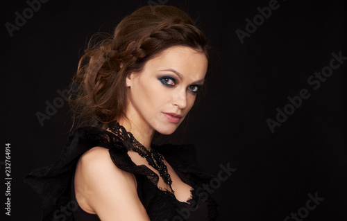 Pretty Woman With Beautiful Hairdo In A Black Dress Buy This Stock