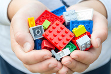 Colored Toy Bricks  In Child Hands.