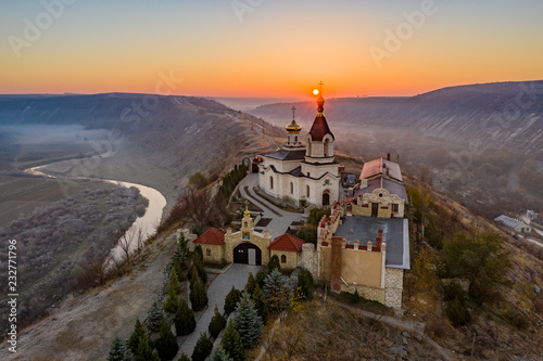 Tuinposter Chocoladebruin Sunrise at Old Orhei Monastery in Moldova Republic