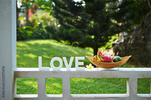 Photo Tropical fruits and word love