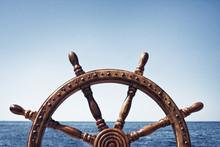 Old Vintage Wooden Helm Wheel On Sea Background