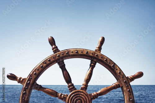Ingelijste posters Schip Old Vintage Wooden Helm Wheel on sea background