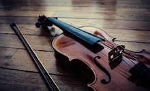 Violin And Bow Resting On The ...