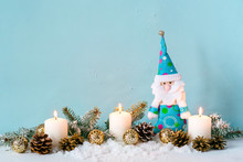 Christmas Blue Composition. Candles And Dwarf Among Fir Branches