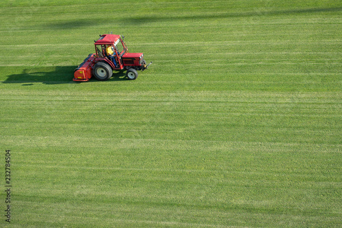 Man in tractor aerating a soccer field Fototapeta