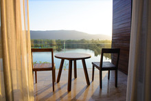 Balcony Of House Lake View With Wooden Table And Chair