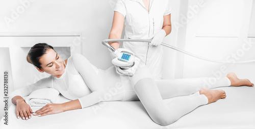 Beautiful woman receiving lpg massage against cellulite