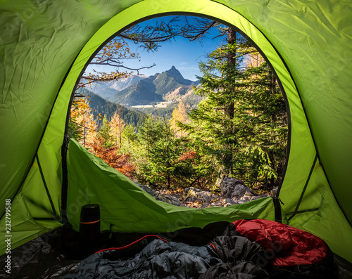 View from tent to Tatra mountains in autumn at sunrise