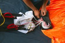Skydiver Packs The Parachute Before Jumping.  Base Jumping.