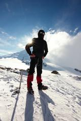 Fototapeta Mountaineer posing on a background mountains.