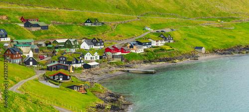 Spoed Foto op Canvas Turkoois Beautiful Scandinavian Village, Located On The Faroe Islands, Settlement on Faroe Islands, Denmark