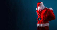 Santa Holding A Red Sack On A Dark Blue Background