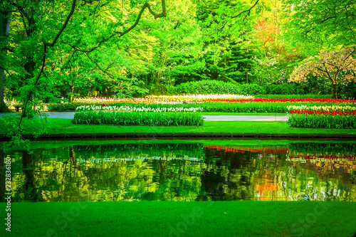 Foto op Canvas Groene fresh spring garden with green trees, fresh grass and river, retro toned