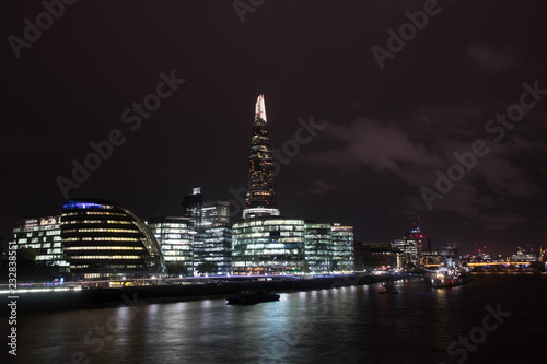 Papiers peints Londres Skyline of London with the lightning Sharp and the modern buildings of the business district along the river Thames