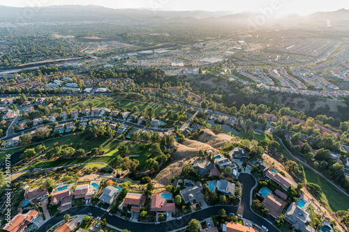 Ingelijste posters Luchtfoto Aerial view of streets, homes and parks in the Porter Ranch area of Los Angeles, California.
