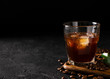 glass cold brew coffee with ice on black or dark background