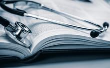 Phonendoscope On Book Of Medic...