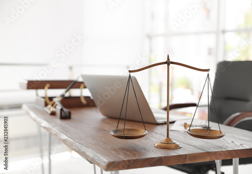 Fotografija Scales of justice on desk in notary's office