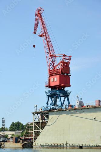 Keuken foto achterwand Poort The port crane on ship dock in port. City Svetlyj, Kaliningrad region
