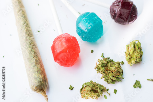 Cuadros en Lienzo Cannabis flower buds with THC infused candy lollipops and hand rolled marijuana