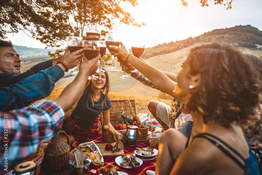 Fototapety, obrazy: Group of friends eating in the nature