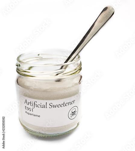 Photo Artificial sweetener aspartame, unhealthy with skull symbol.