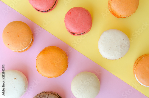 assortment of macarons on yellow - pink background divided diagonally into two t Wallpaper Mural