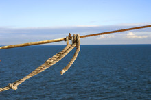 Ship Ropes With A Knot On Blue...