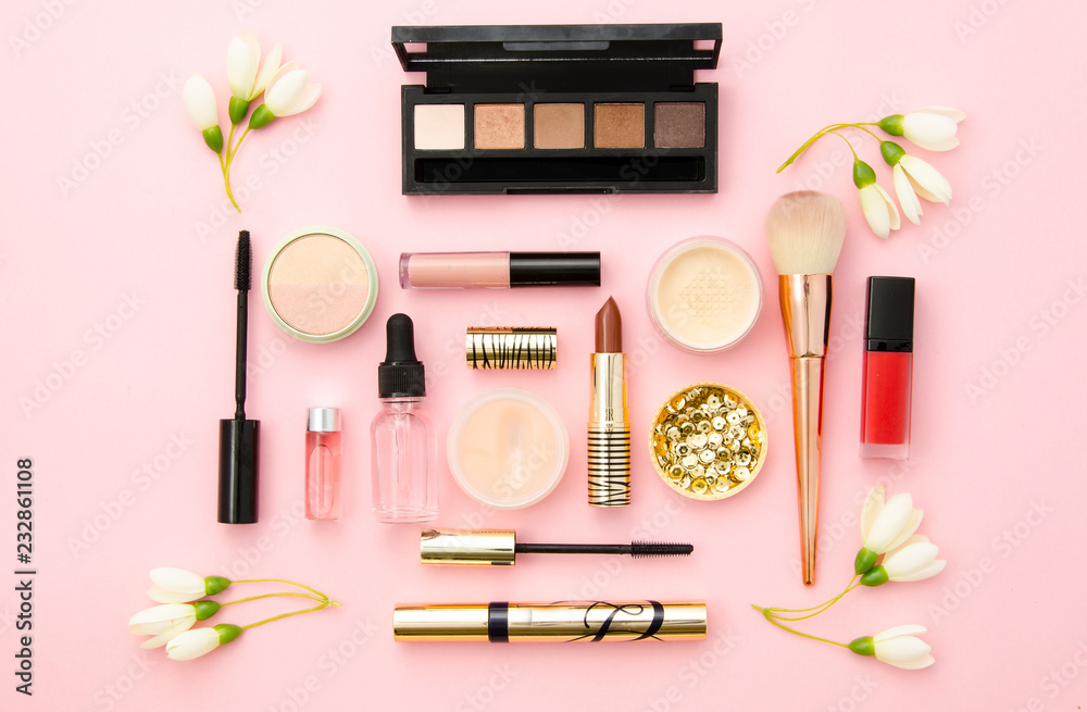 Fototapeta Professional decorative cosmetics, make-up tools and accessory on pink background. Beauty, fashion and shopping concept. flat lay composition, top view. Mockup for beauty blog