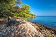 Pebble beach on Brac island with turquoise clear ocean water, Supetar, Brac, Croatia