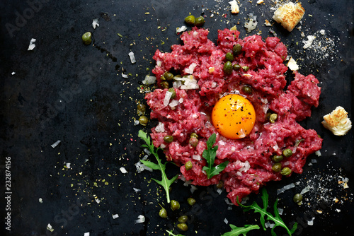 Beef tartare - traditional dish of french cuisine.Top view.