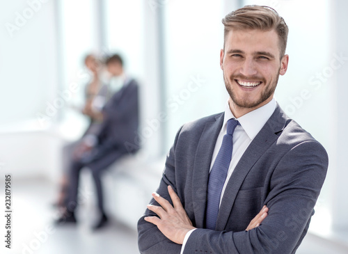 successful businessman on the background of a bright office. Fotobehang
