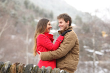 Happy Couple Hugging In Winter Holiday