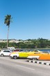 Vintage american cars parked on sunny sea shore