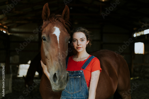 Portrait of a girl and a horse