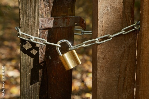 Old gate with padlock